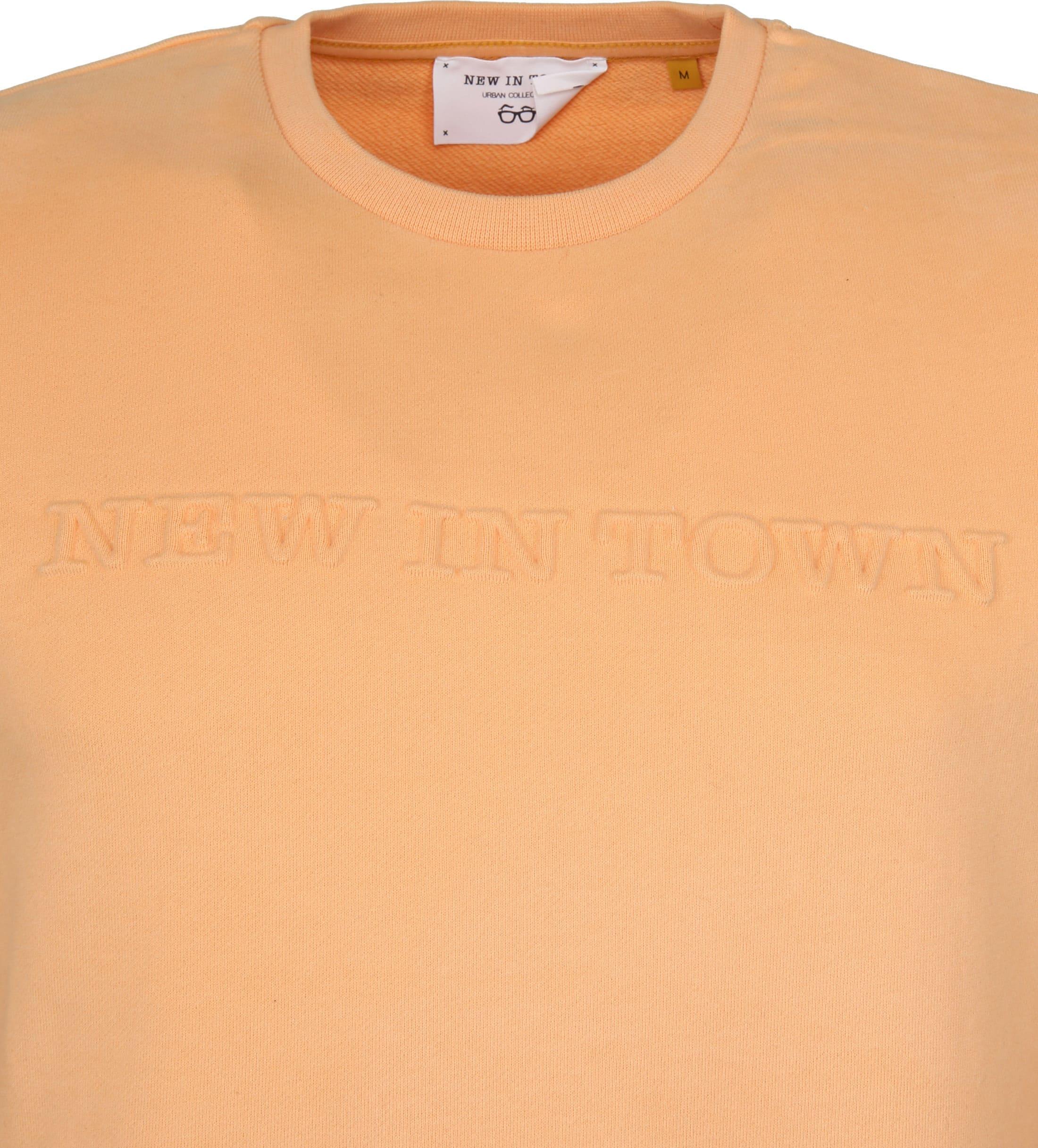 New In Town Sweater Oranje foto 2
